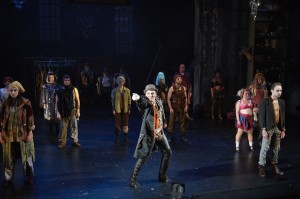 Bradley Greenwald and Ensemble in Three Penny Opera.  Photo by Tony Nelson.